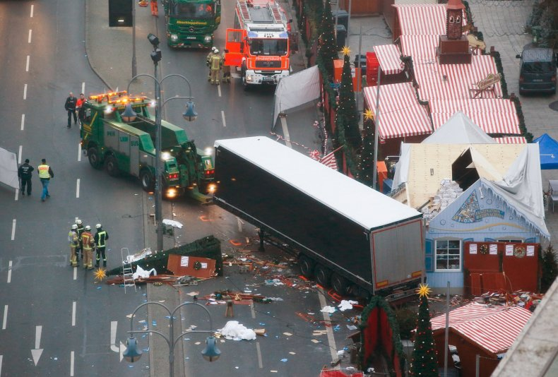 Rescue workers tow away the lorry from the Berlin attack