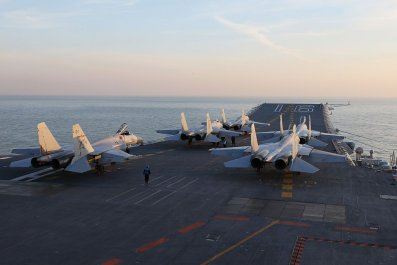 Chinese J-15 fighter jets on the deck of the Liaoning aircraft carrier