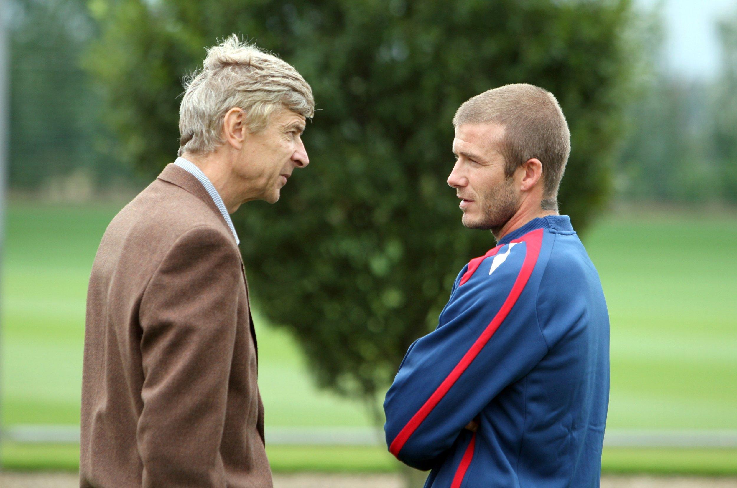 Arsenal manager Arsene Wenger, left, with David Beckham.