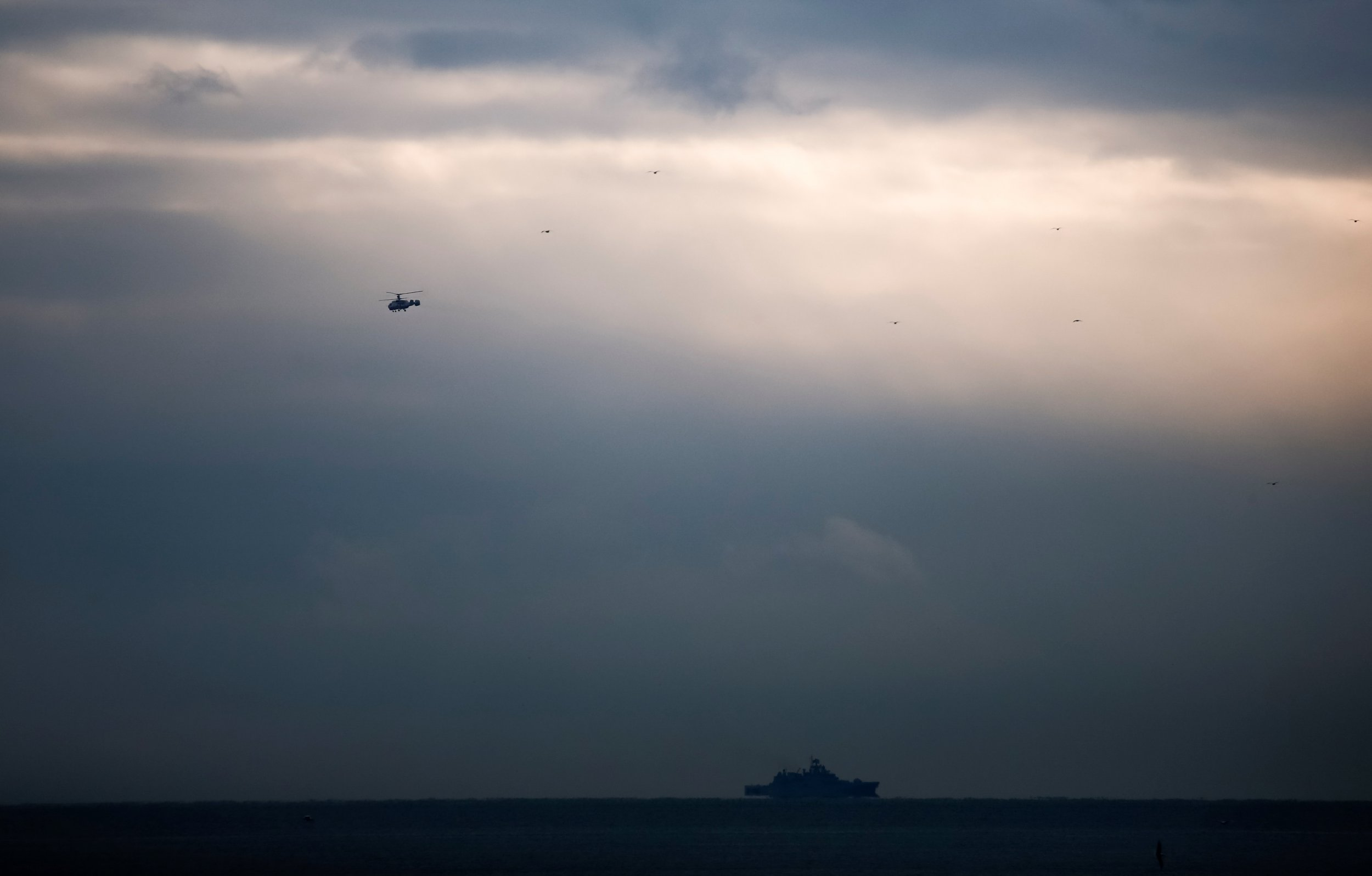 Helicopter searches for crashed Russian military plane