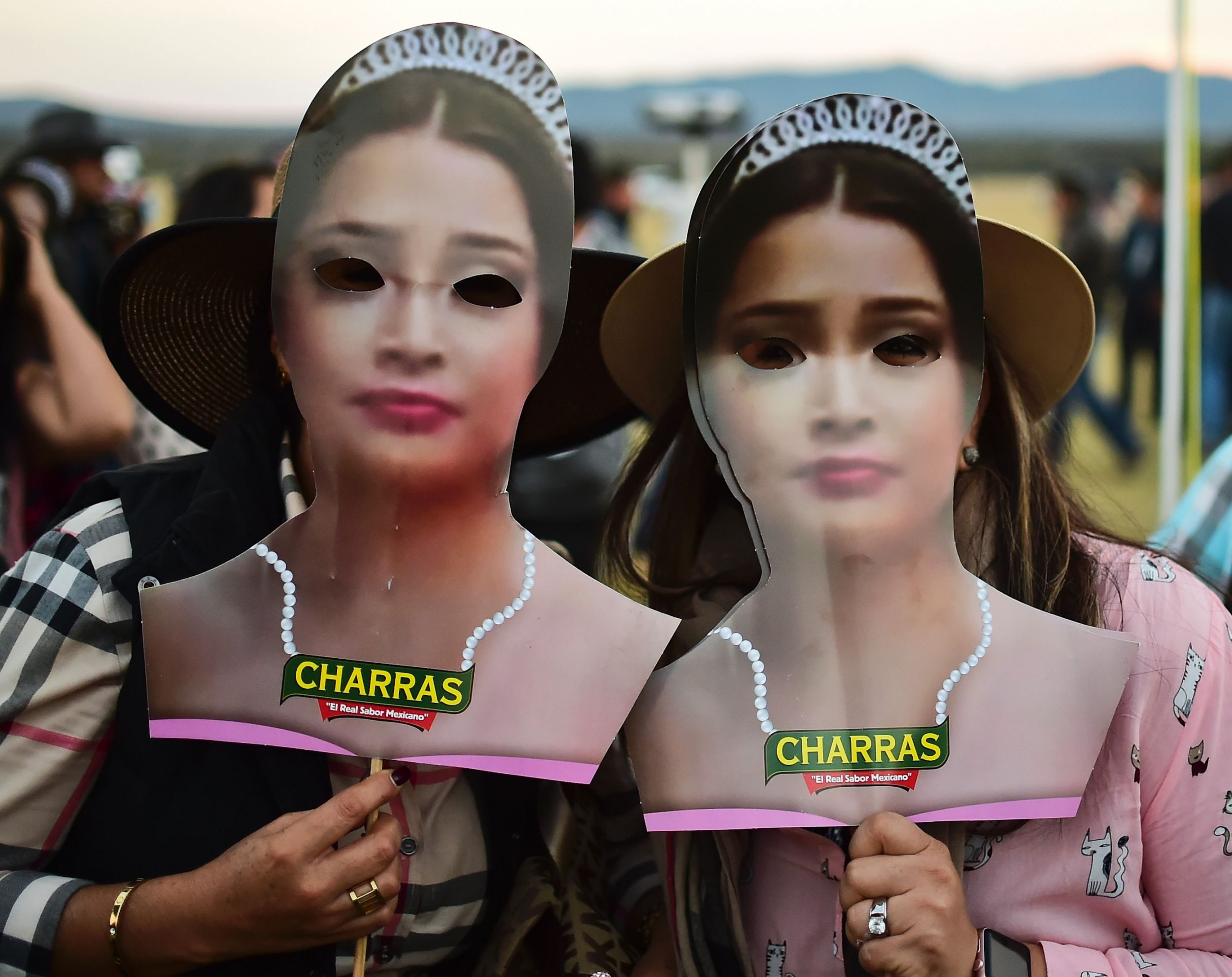 eb9d3379bee Rubi Ibarra Mexico Birthday Two women use masks depicting Mexican teenager  Rubi Ibarra during her birthday party ...