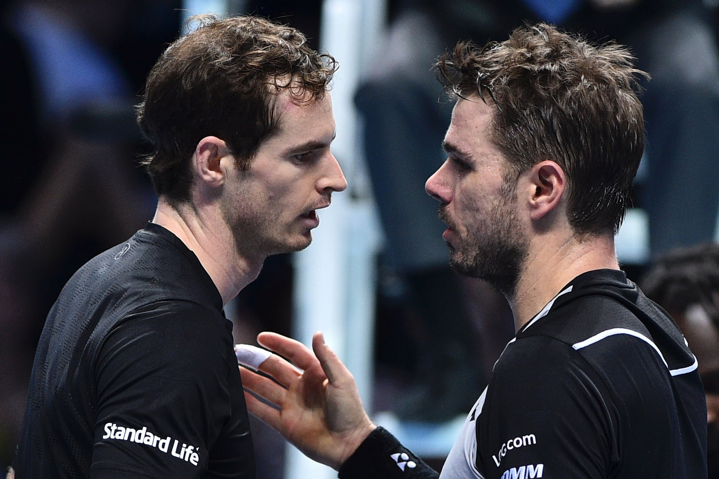 World number one Andy Murray, left, with rival Stan Wawrinka.