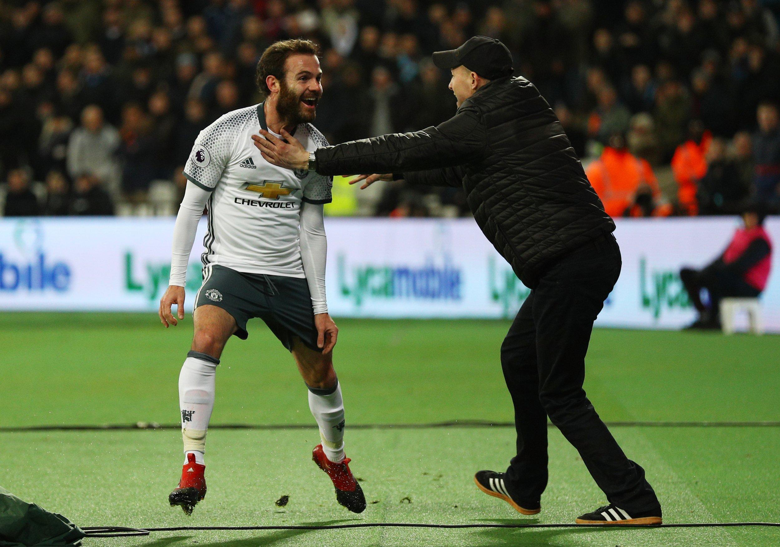 Manchester United midfielder Juan Mata, left.