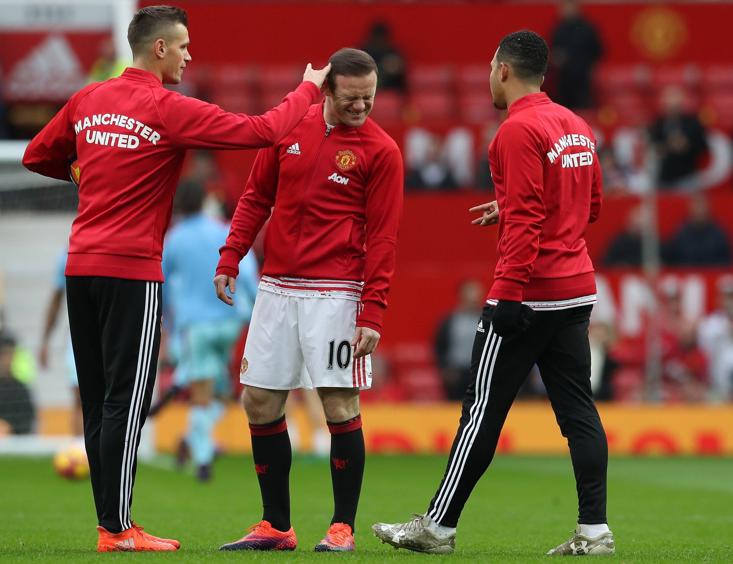 Manchester United midfielder Morgan Schneiderlin, left.