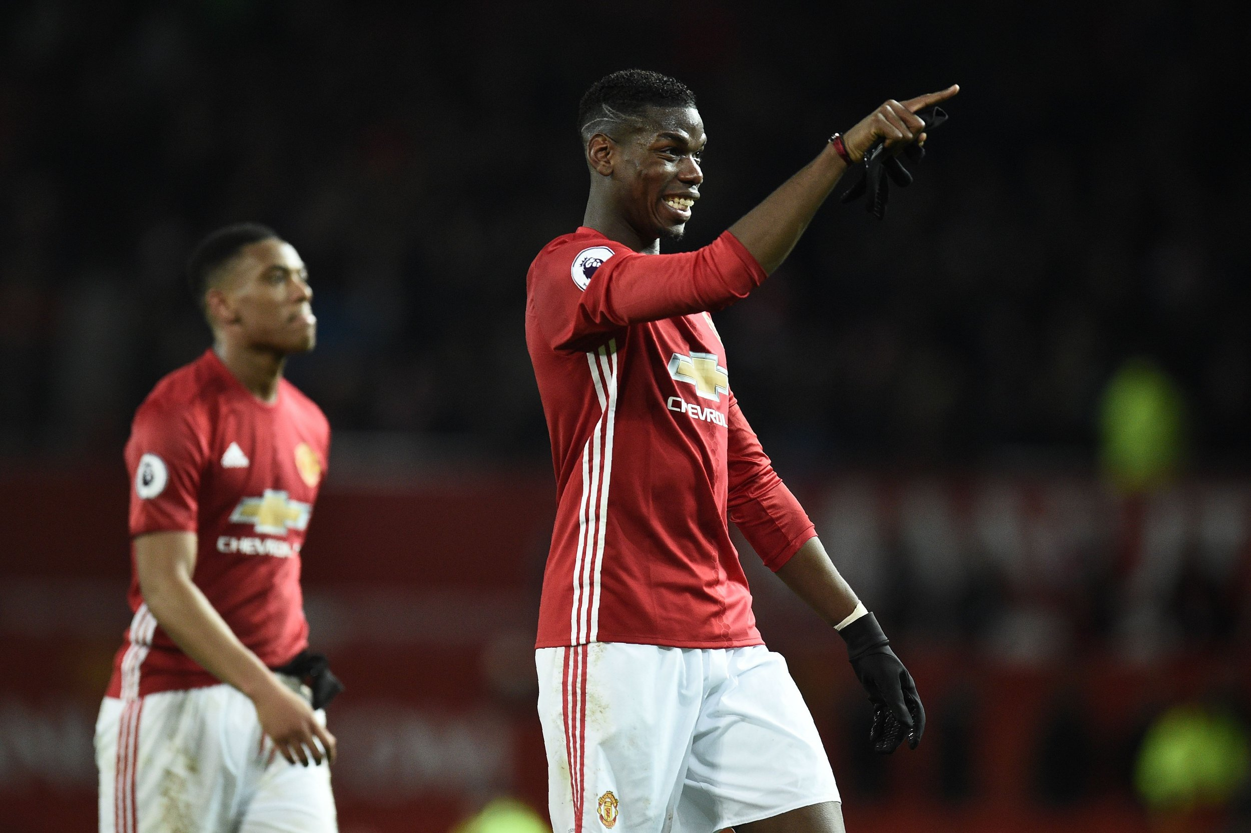 Manchester United star Paul Pogba, right.