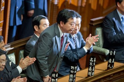Japan's Prime Minister Yoshihiko Noda bows deeply at the lower house of parliament in Tokyo August 30, 2011.
