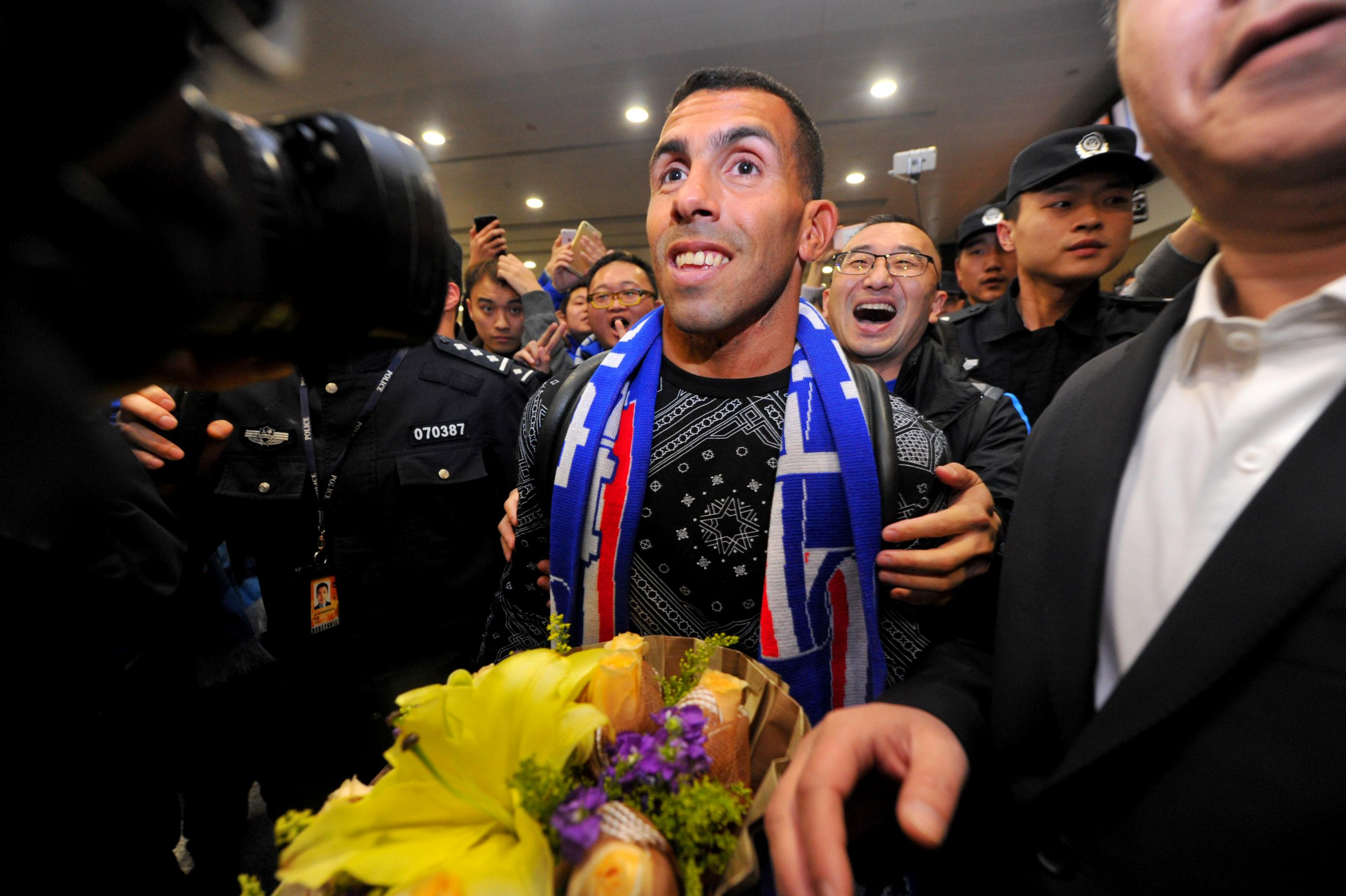 Argentine striker Carlos Tevez at Shanghai Pudong International Airport