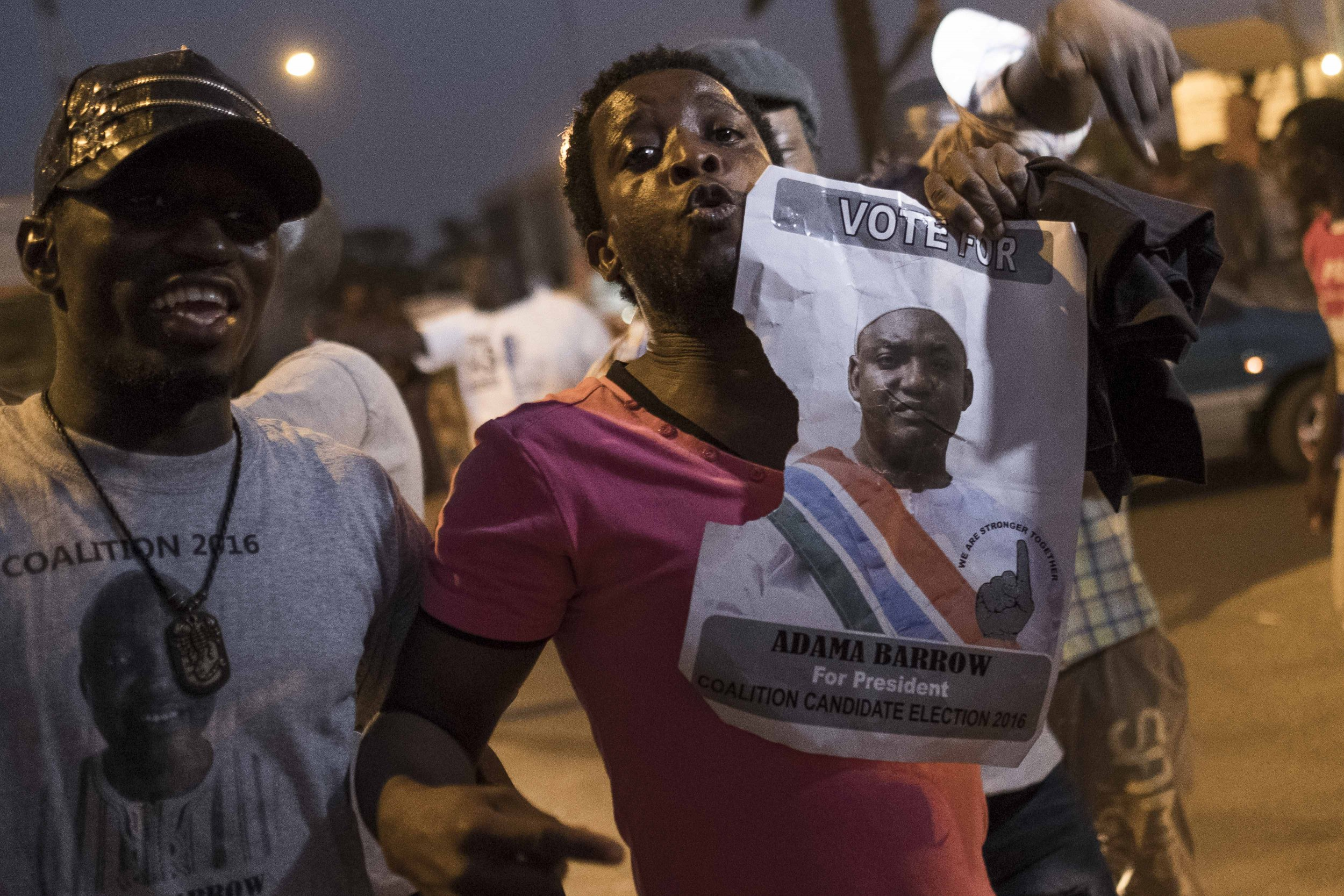 Gambians with Adama Barrow poster