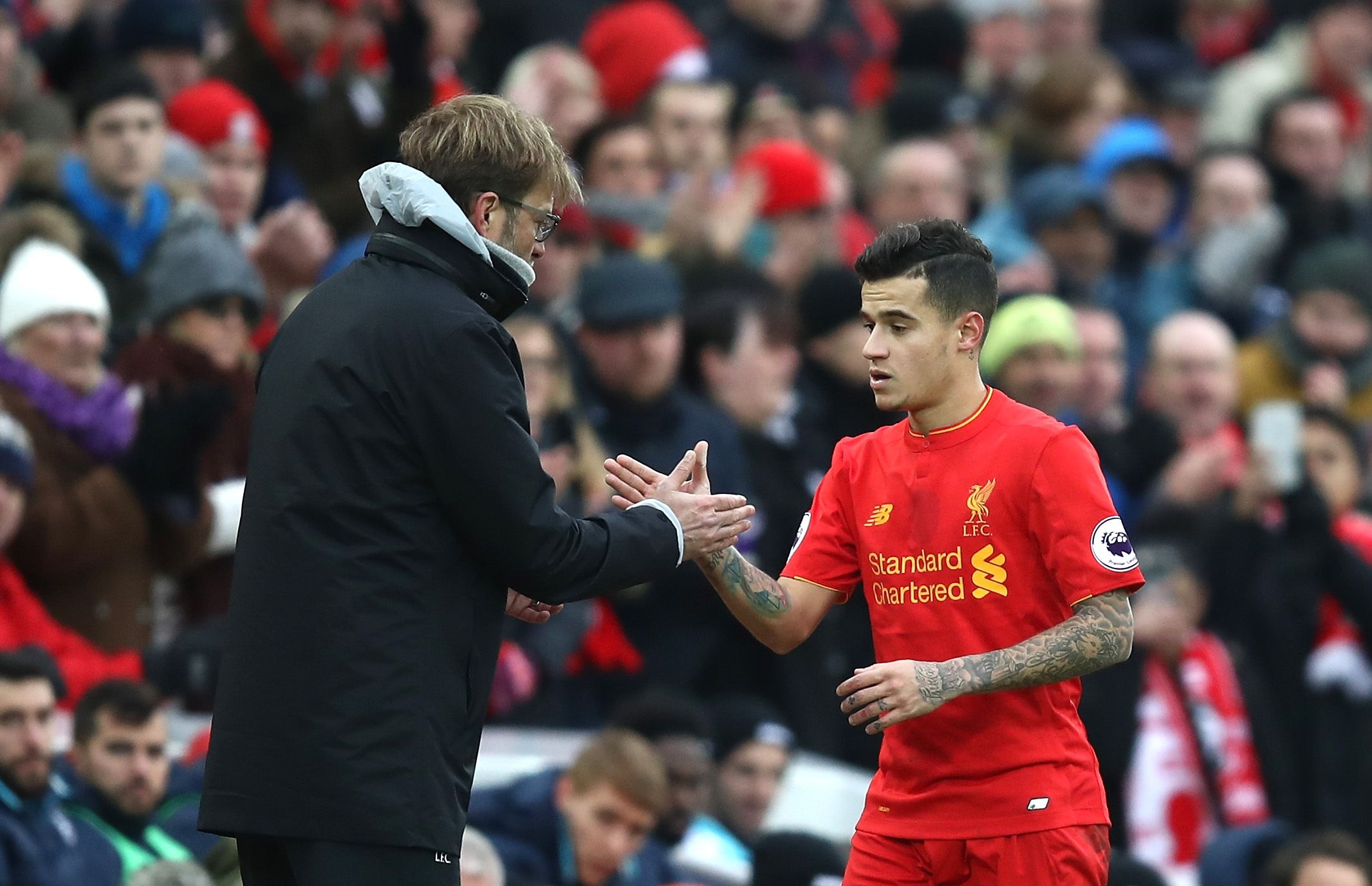 Liverpool manager Jurgen Klopp, left, with Philippe Coutinho.