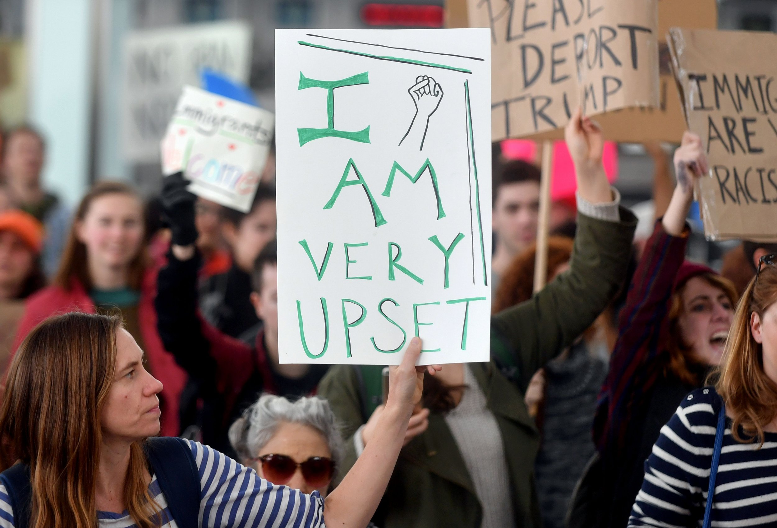 Protesters against Donald Trump's executive order hold up signs at San Francisco International Airport in San Francisco, California.