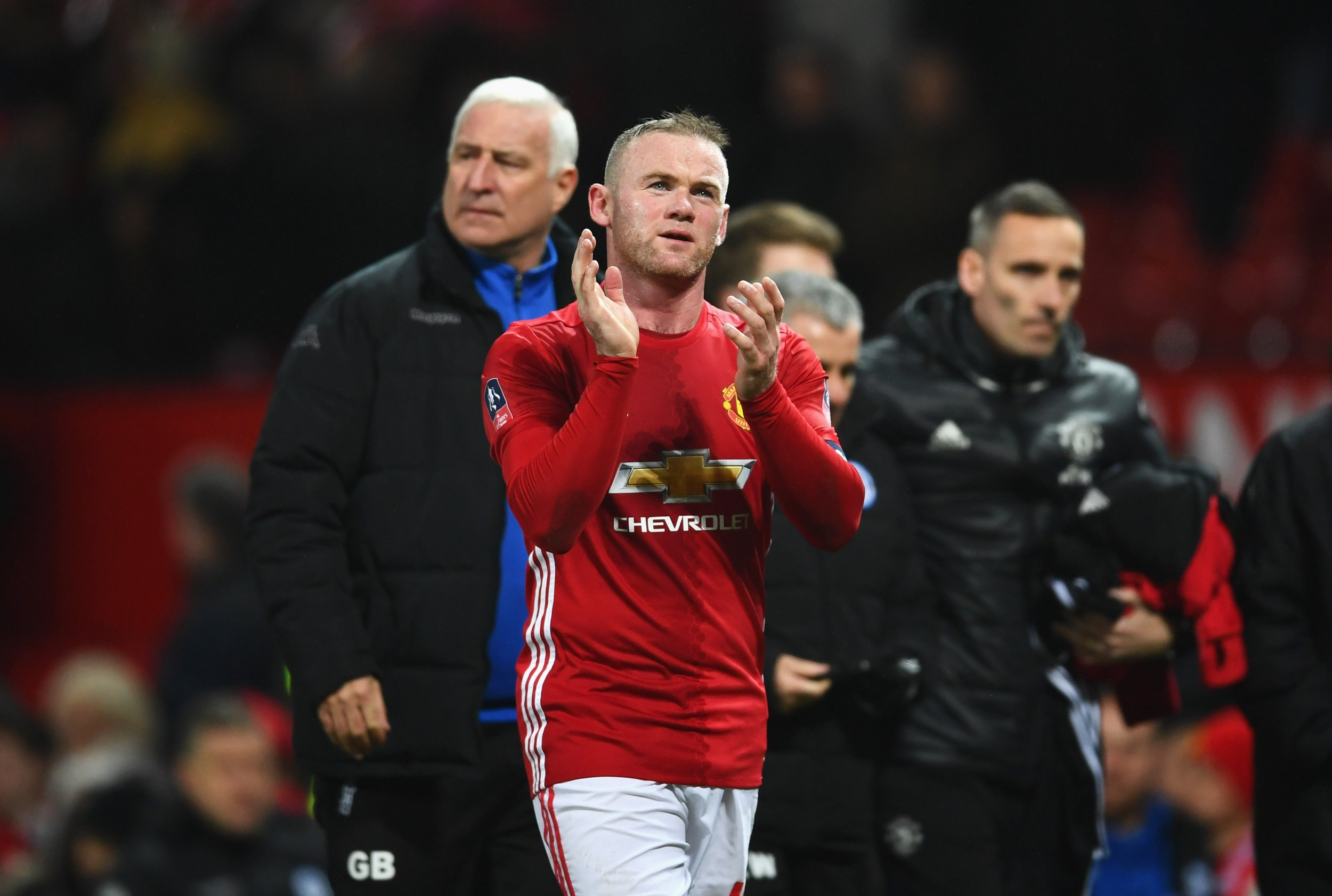 Manchester United striker Wayne Rooney, center.