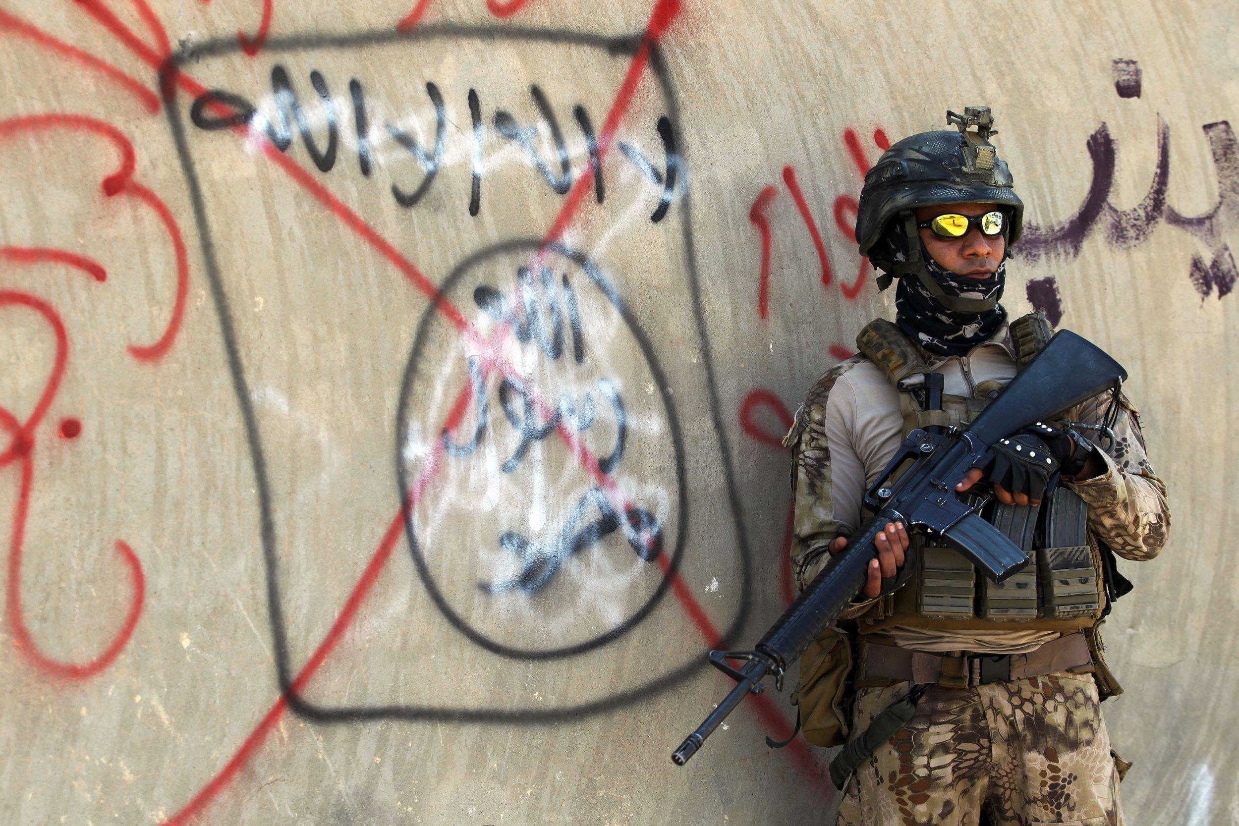 Iraqi soldier ISIS graffiti