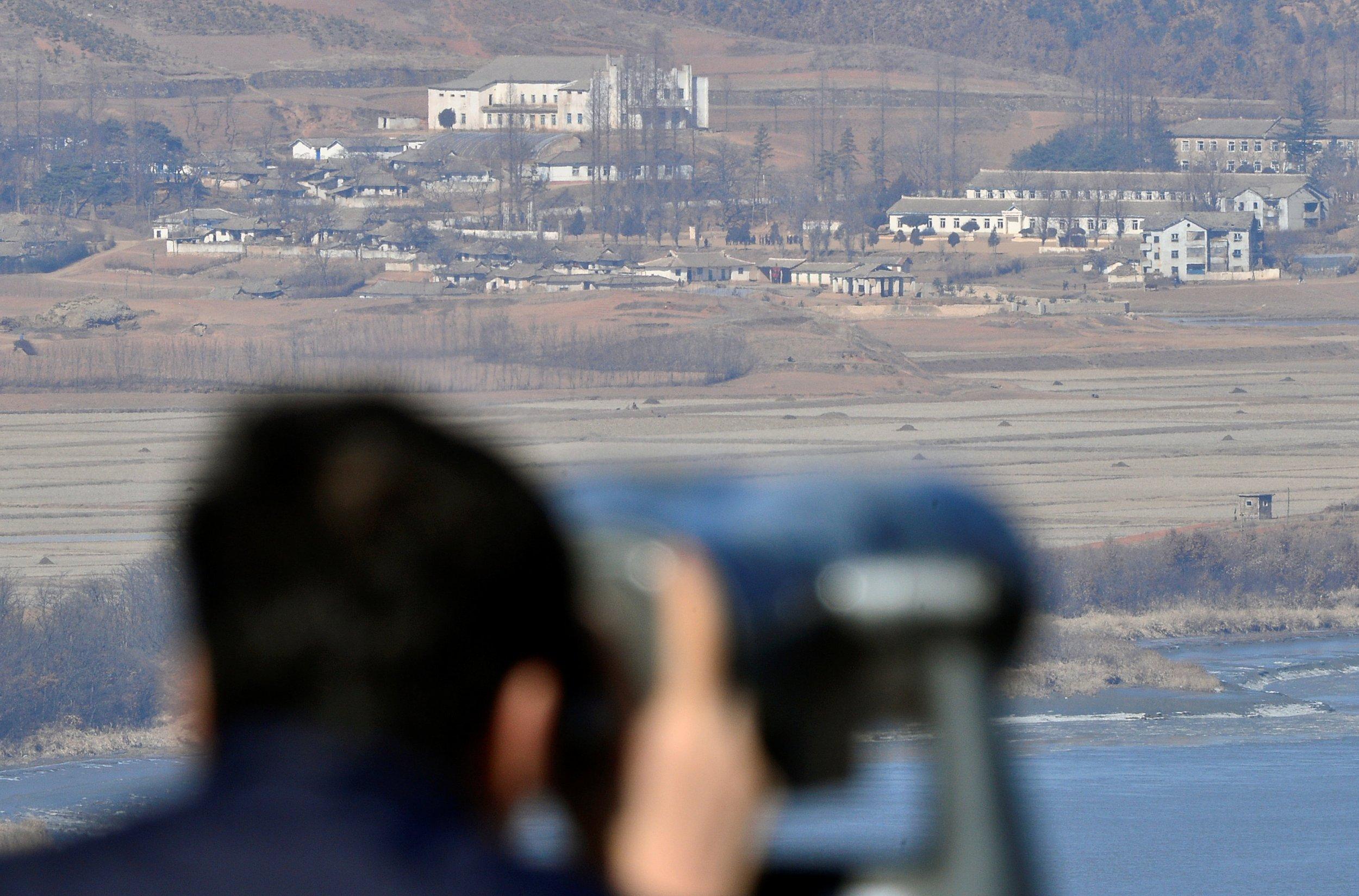 A man looks towards North Korea