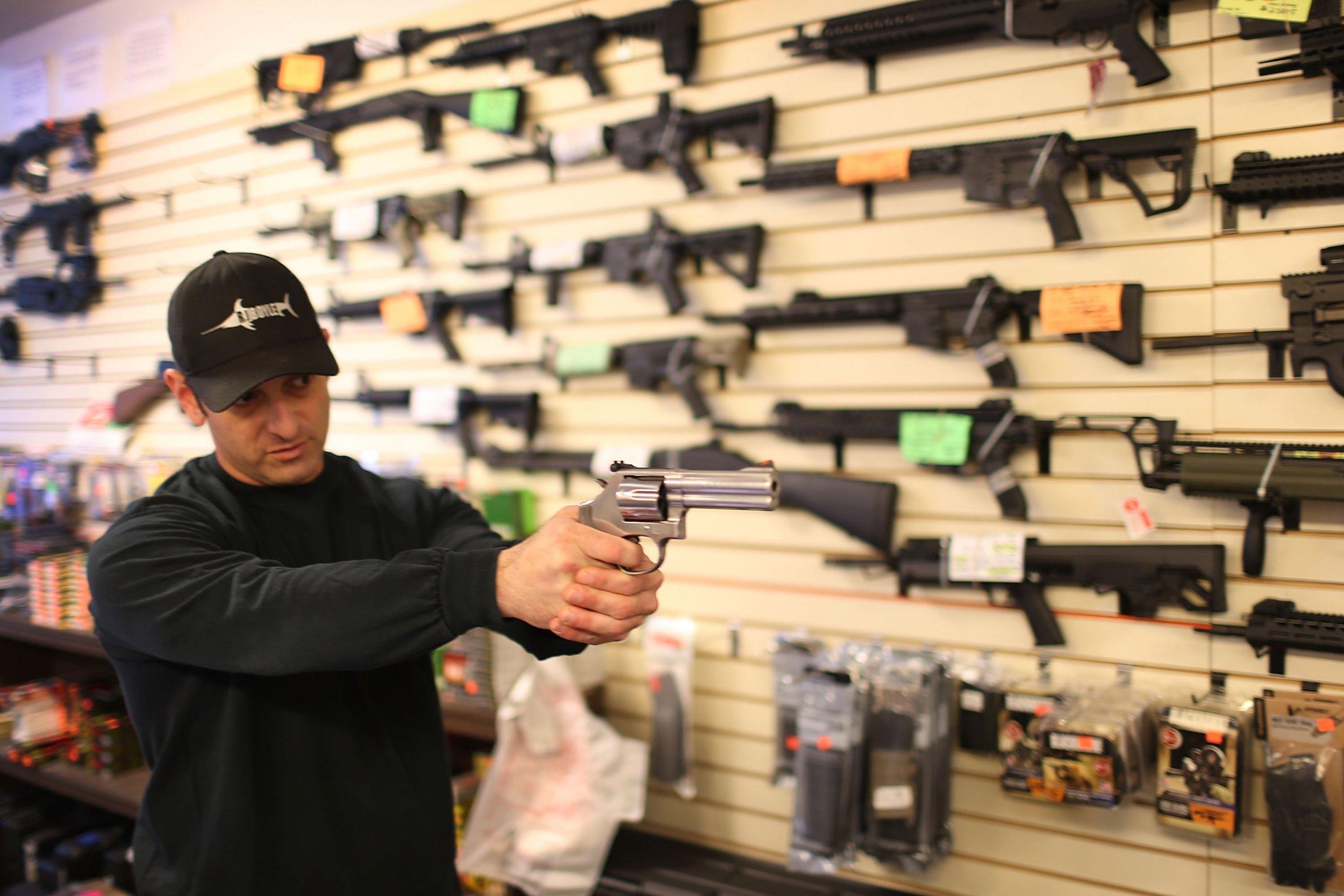 A man holds a gun