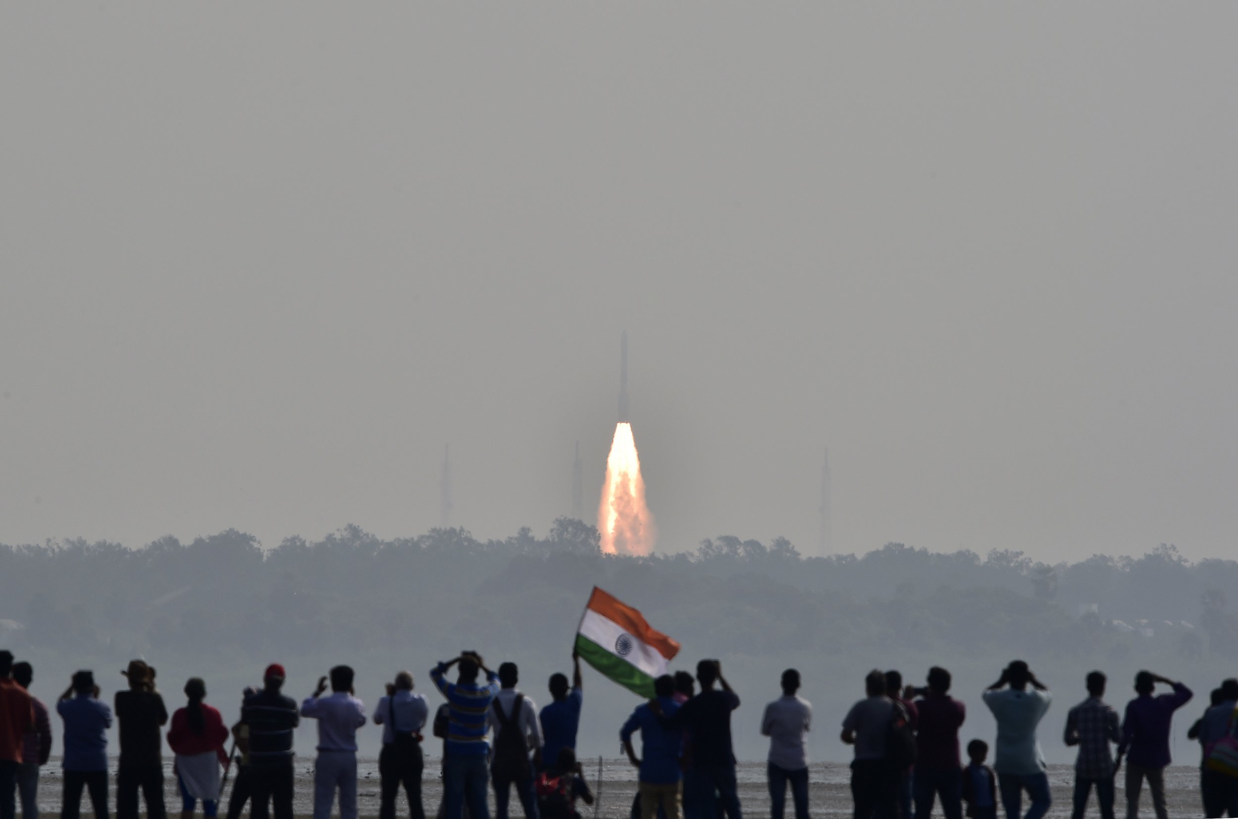 Indians watch satellite launch