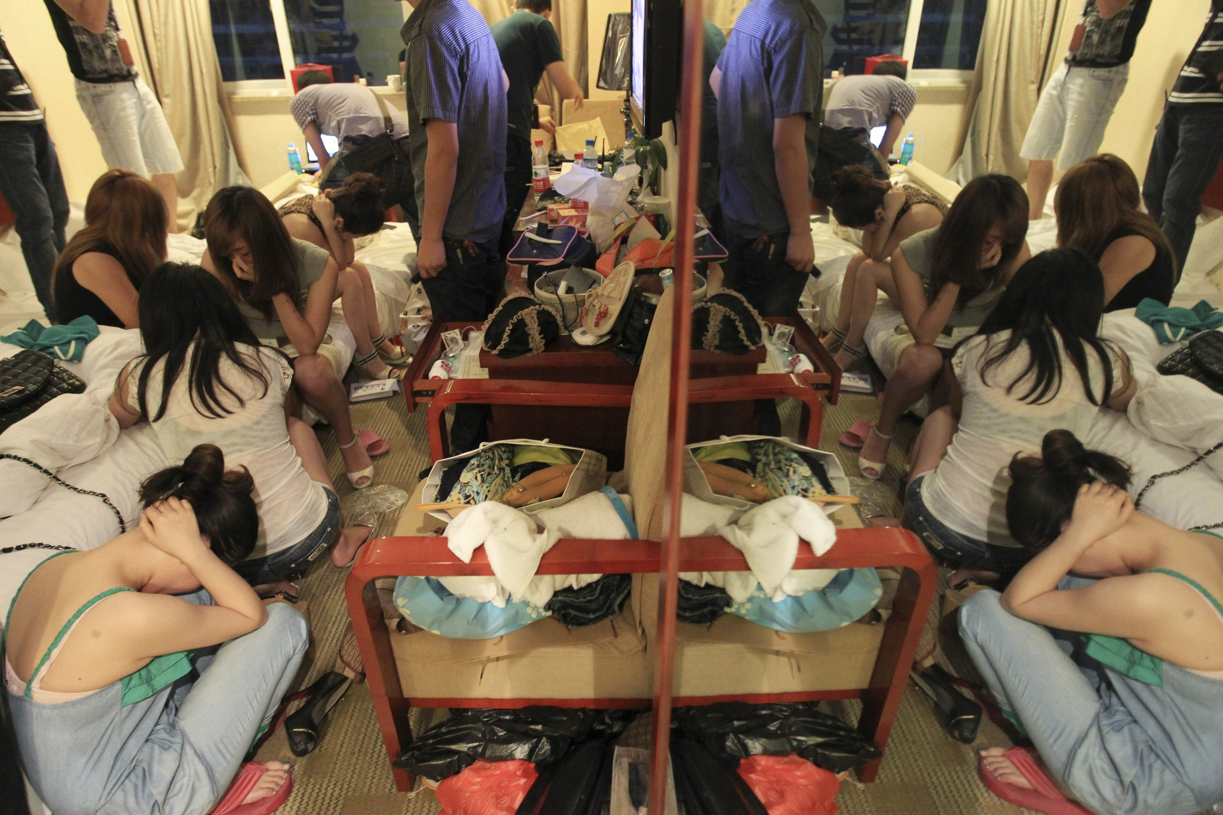 Women hide faces during China crackdown prostitutes