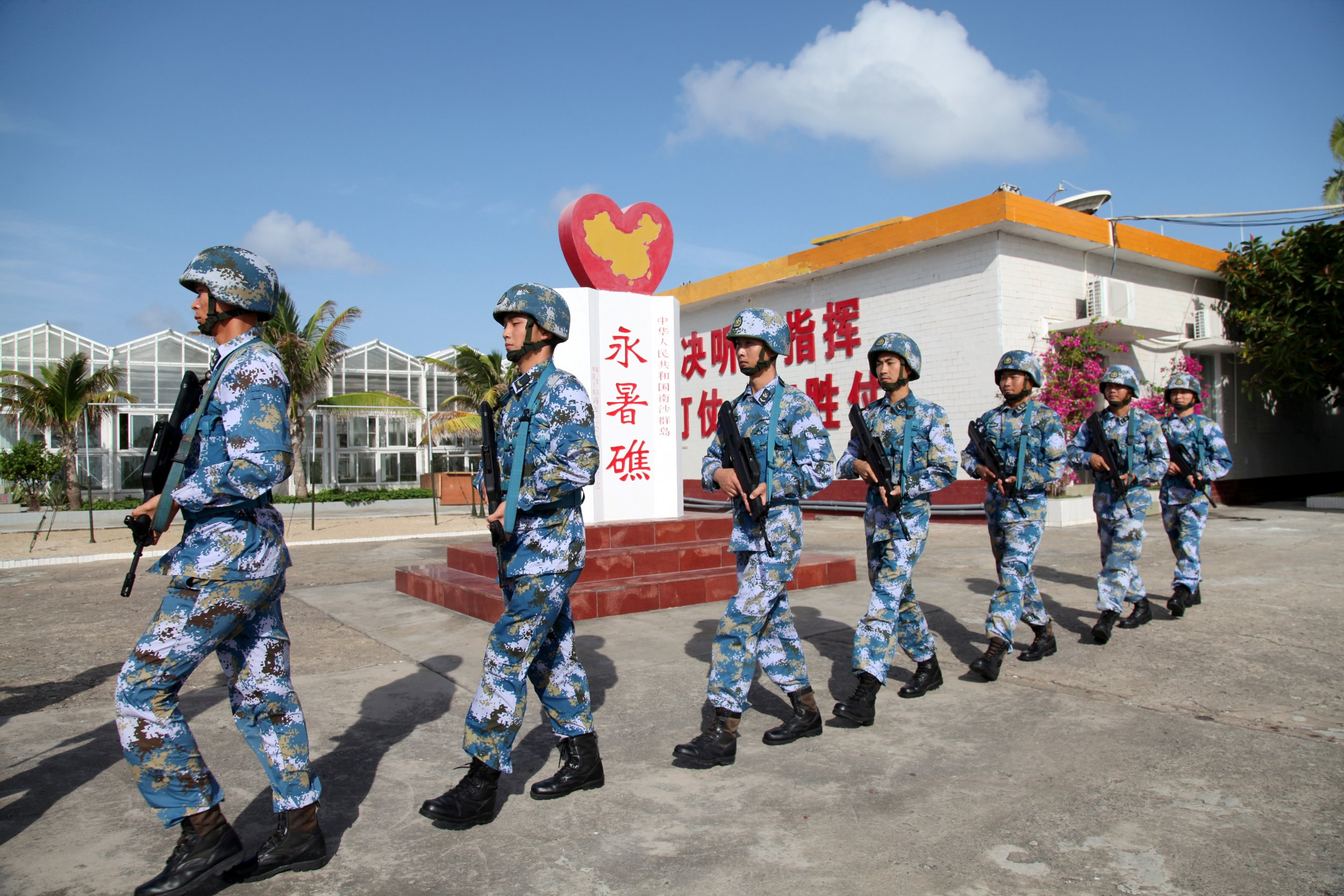Soldiers march in the Spratly Islands