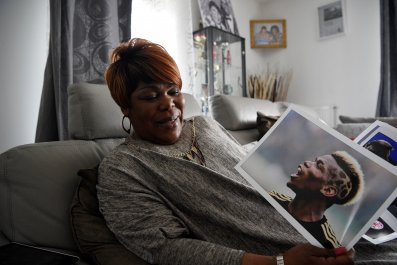 Yeo Moriba shows a picture of her son, Manchester United midfielder Paul.