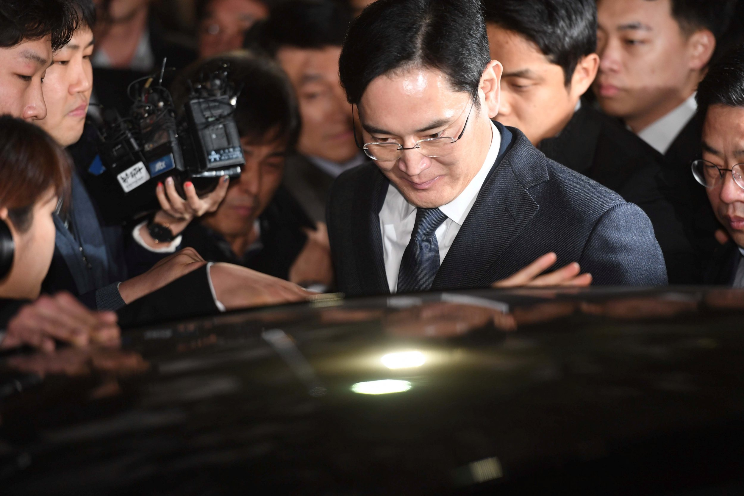 Samsung chief getting into car