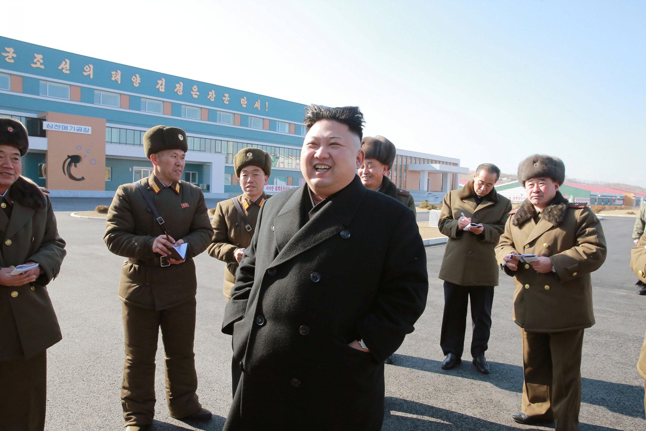 Kim Jong Un laughs