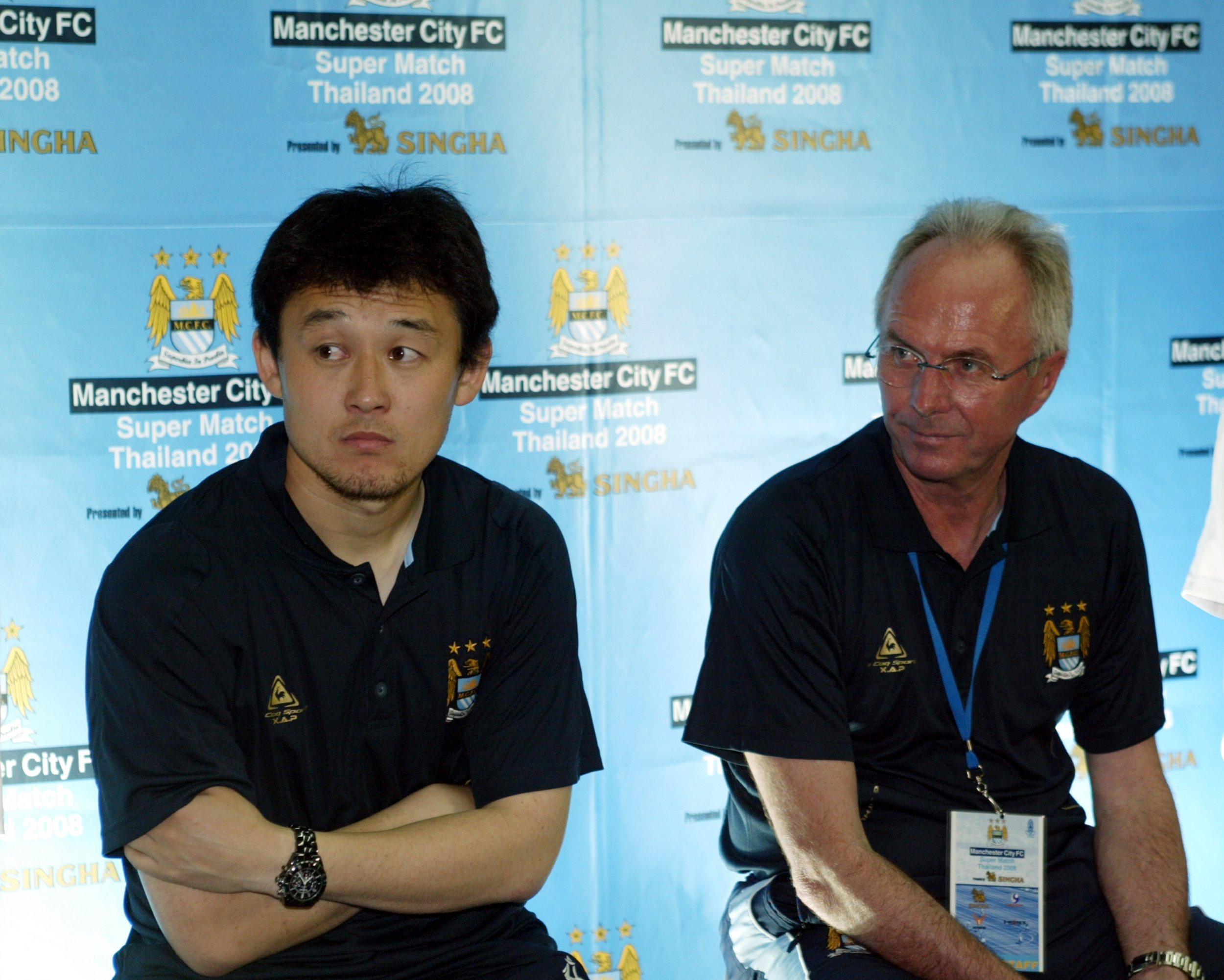 Former Manchester City defender Sun Jihai, left.