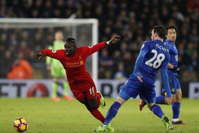 Liverpool's Sadio Mané, left, with Leicester City's Christian Fuchs.
