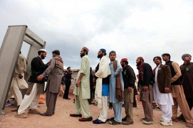 Men queue to access Qadri shrine