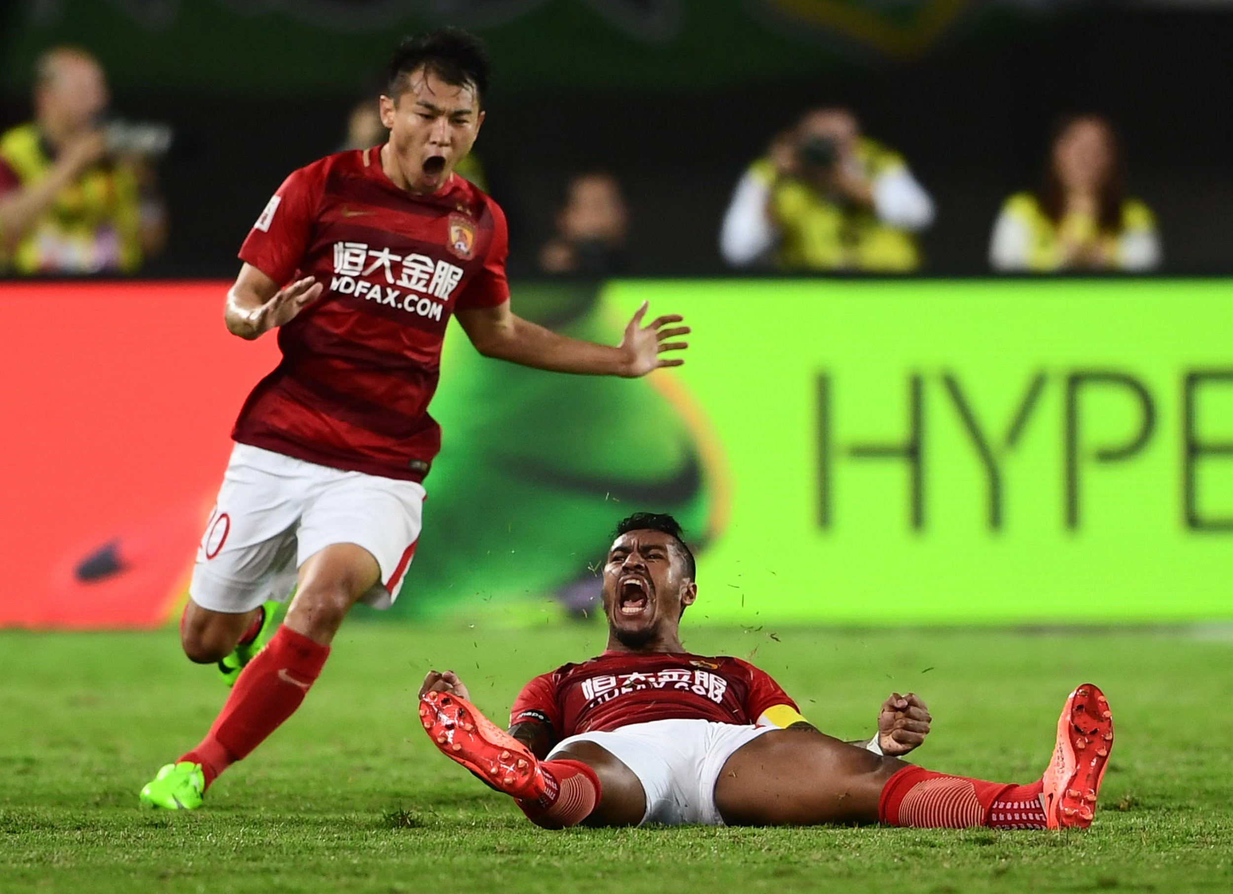 Guangzhou Evergrande celebrate at the end of their Chinese Super League football match against Beijing Guoan in Guangzhou, March 5.