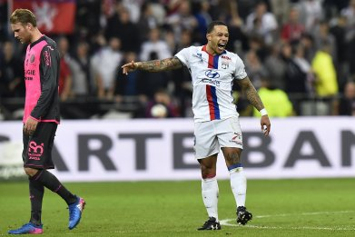 Manchester United winger Memphis Depay, right, on loan at Lyon.