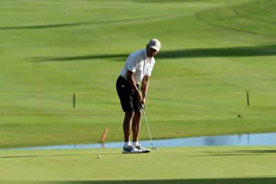 Barack Obama takes an unannounced trip to Hawaii and is spotted golfing with minimal security.