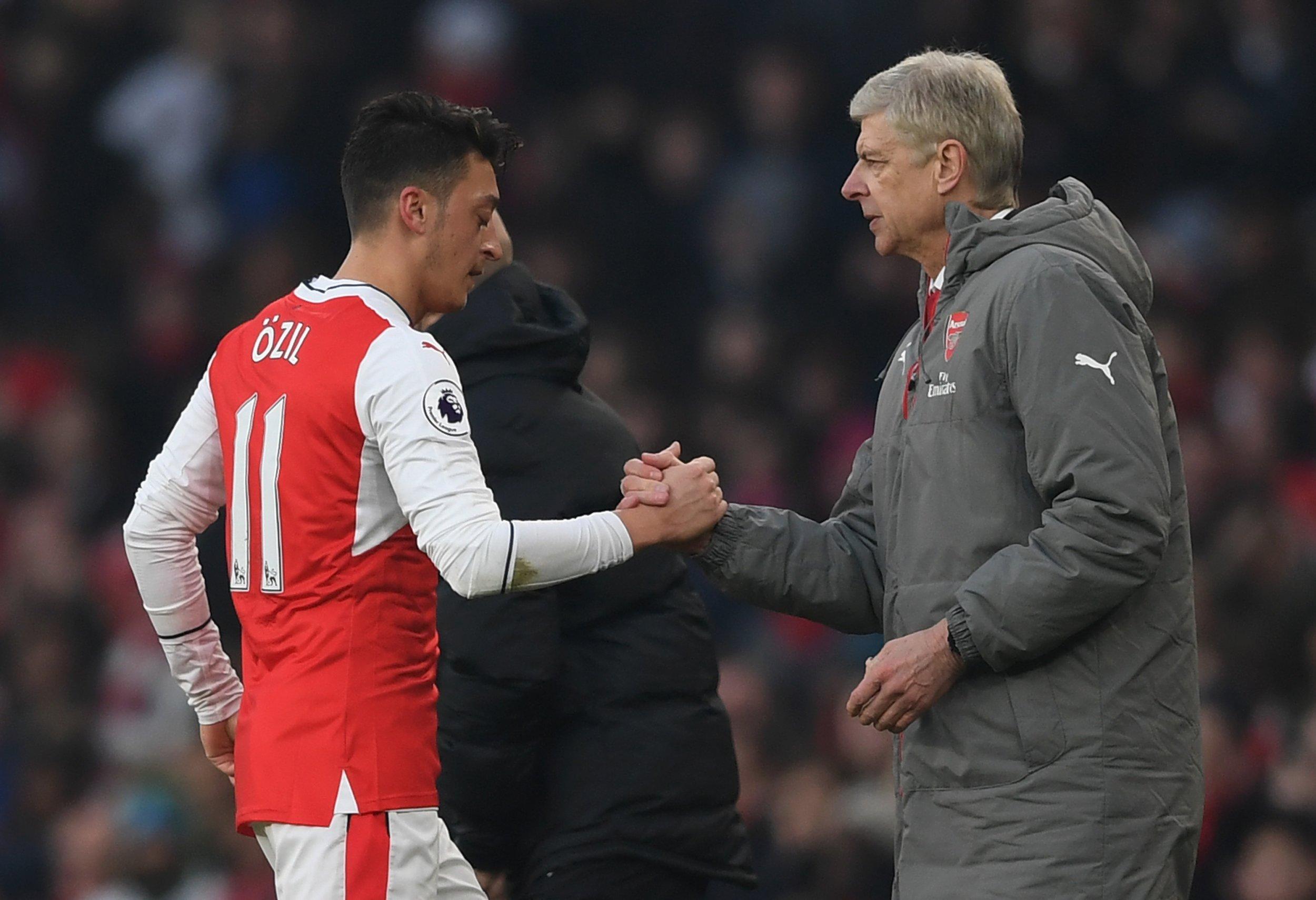 Arsenal star Mesut Ozil, left, with manager Arsene Wenger.