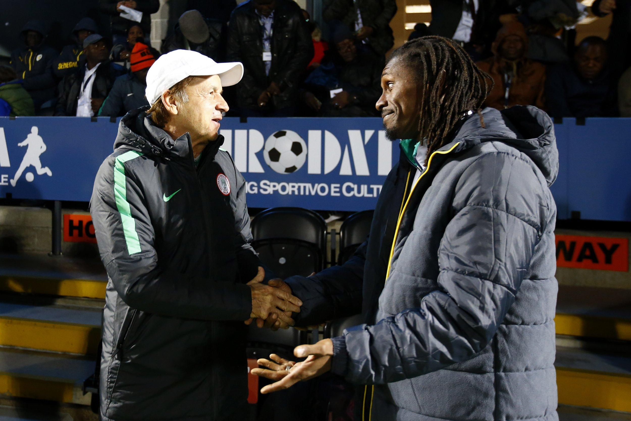 Nigeria coach Gernot Rohr, left, with Senegal coach Aliou Cisse at The Hive, Barnet, London, March 23.