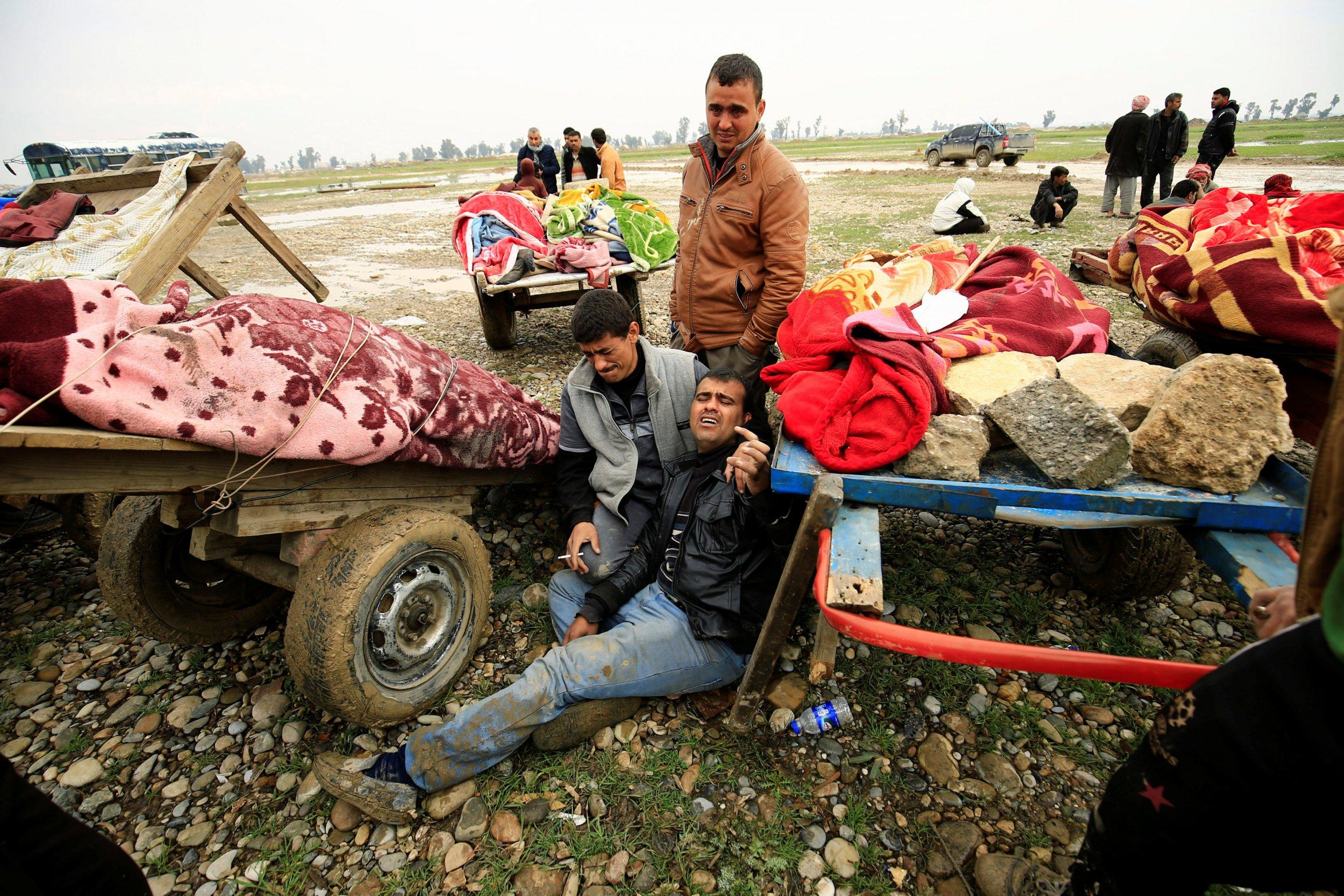 Mosul civilians near bodies