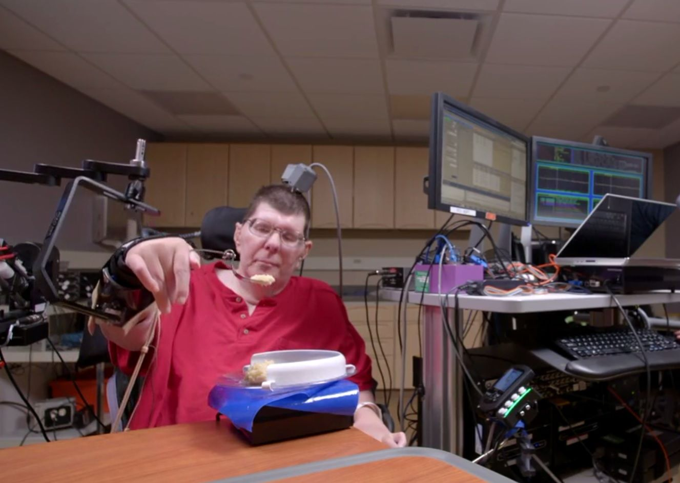 brain implant prosthetic paralused quadriplegic