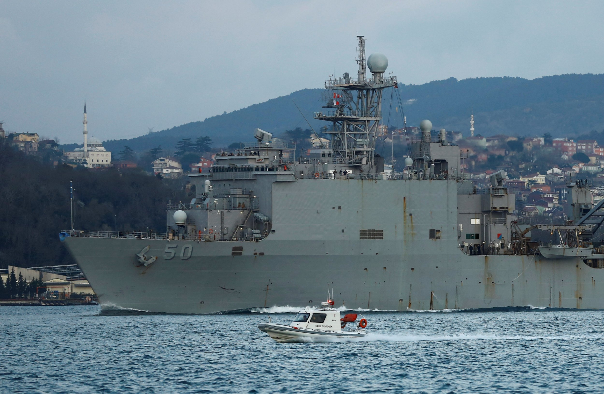 Russia and nato war games raise tensions in black sea uss carter hall a dock landing ship of the us navy sets sail in the bosphorus on its way to the black sea in istanbul turkey march 17 2017 publicscrutiny Choice Image