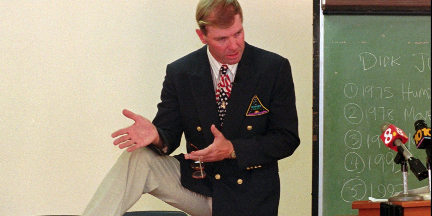 a0ba933b30 Dick Joslyn, former member of the Heaven's Gate cult, displays his black  Nike sneakers at a news conference on April 18, 1997 in San Diego.