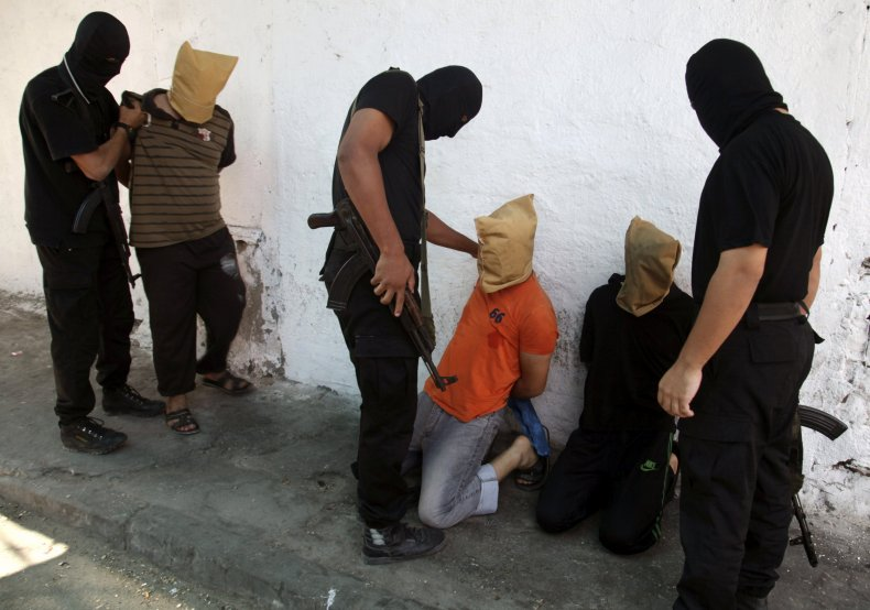 Hamas militants with suspected collaborators