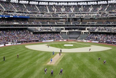 Teams captained by Shane Warne and Sachin Tendulkar play during a Cricket All-Star exhibition match at Citi Field in New York, November 7 2015.
