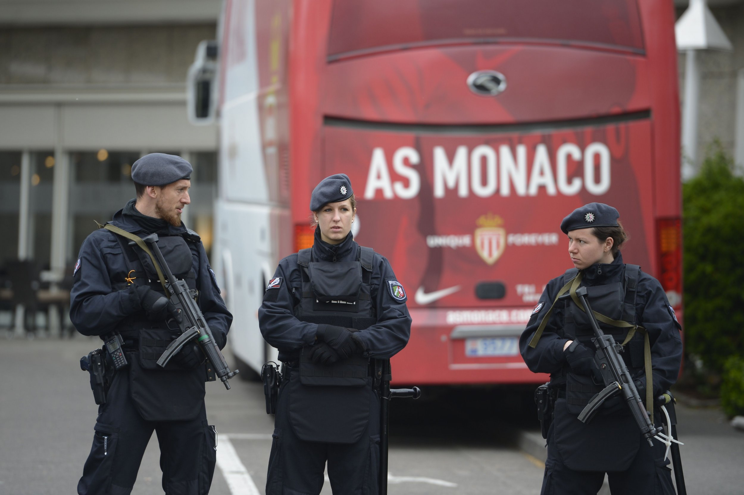 Policemen stand guard in front of the AS Monaco team bus in Dortmund, western Germany, April 12.