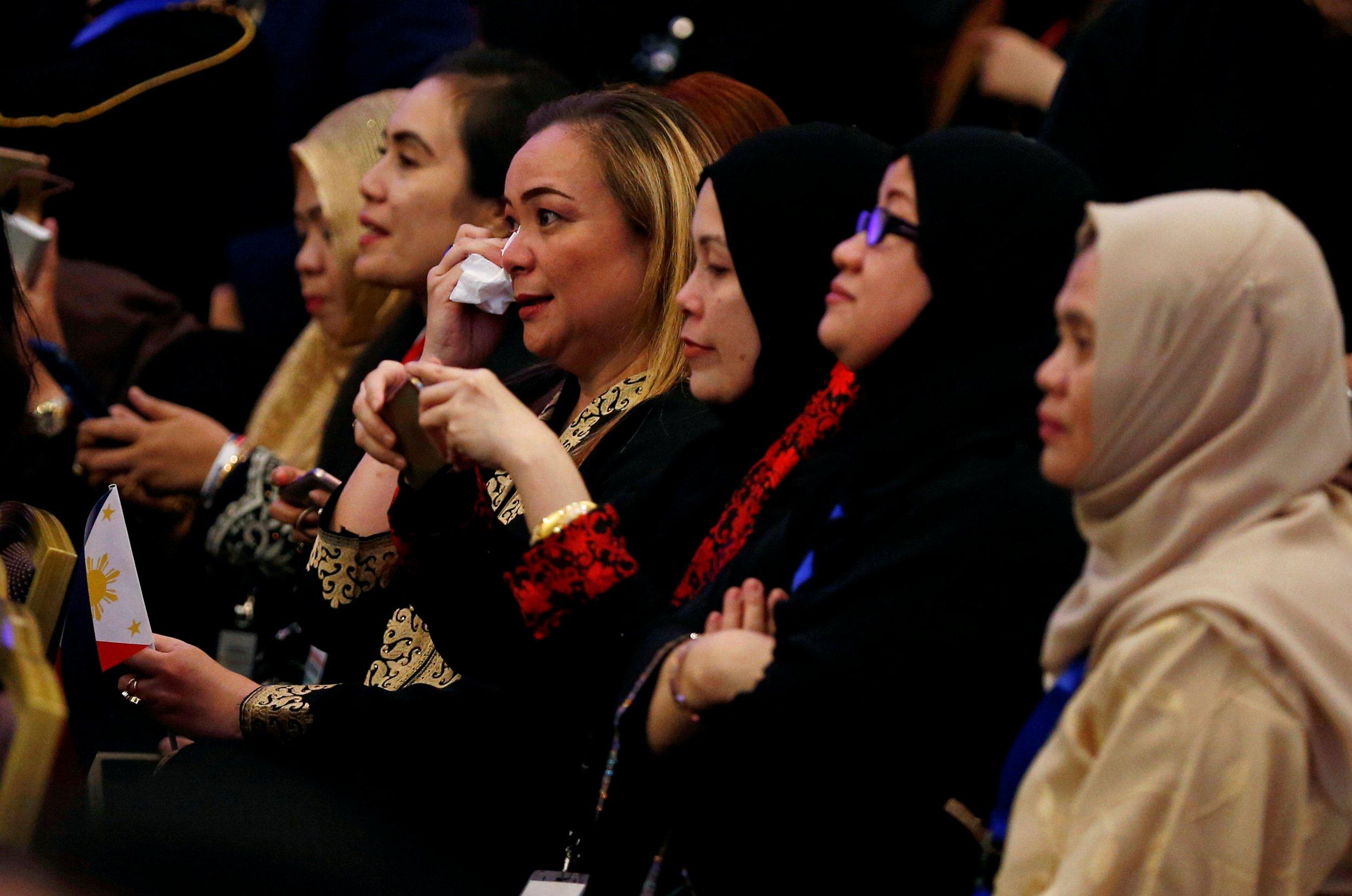 Women watch Duterte