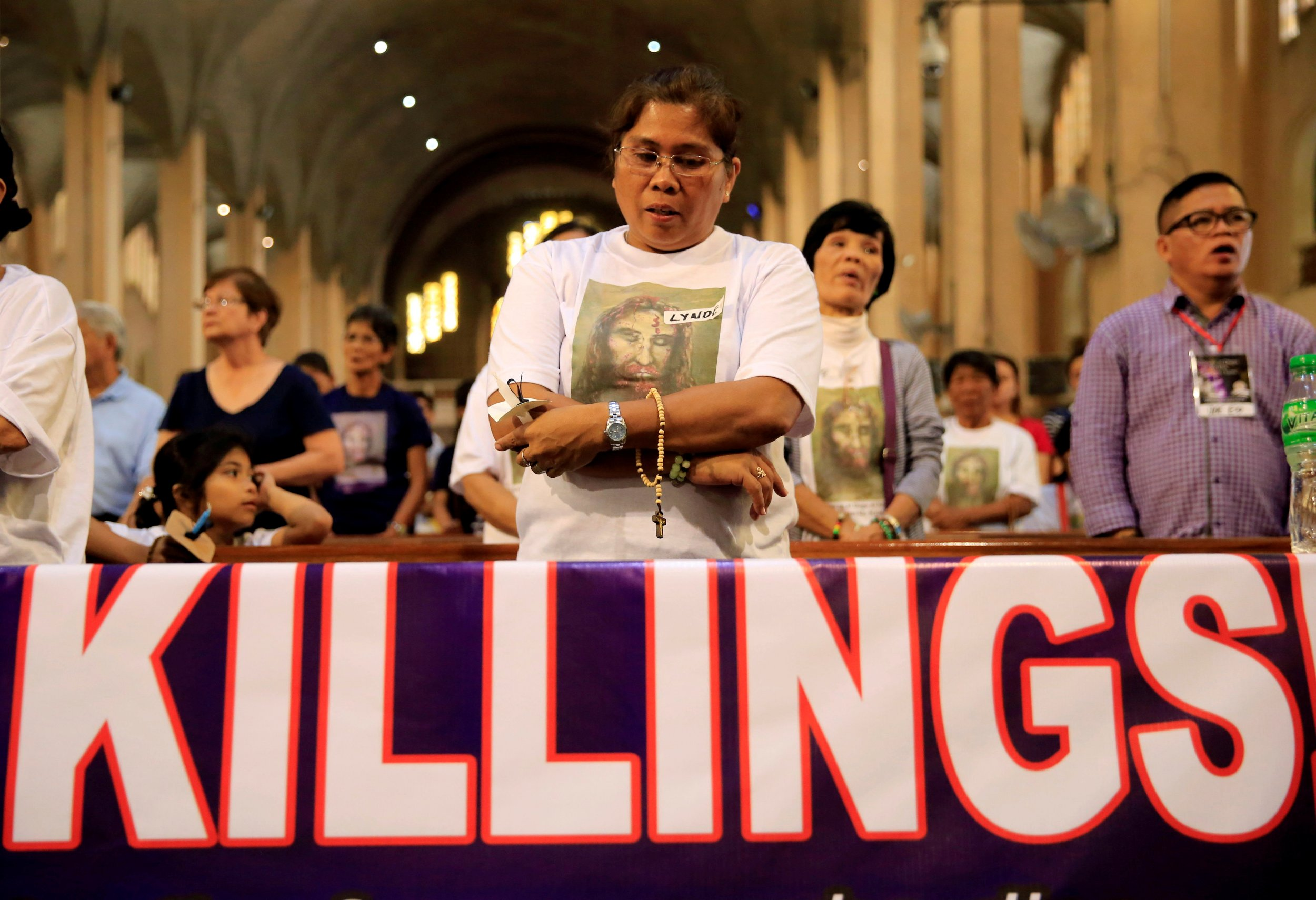 Woman protests killings