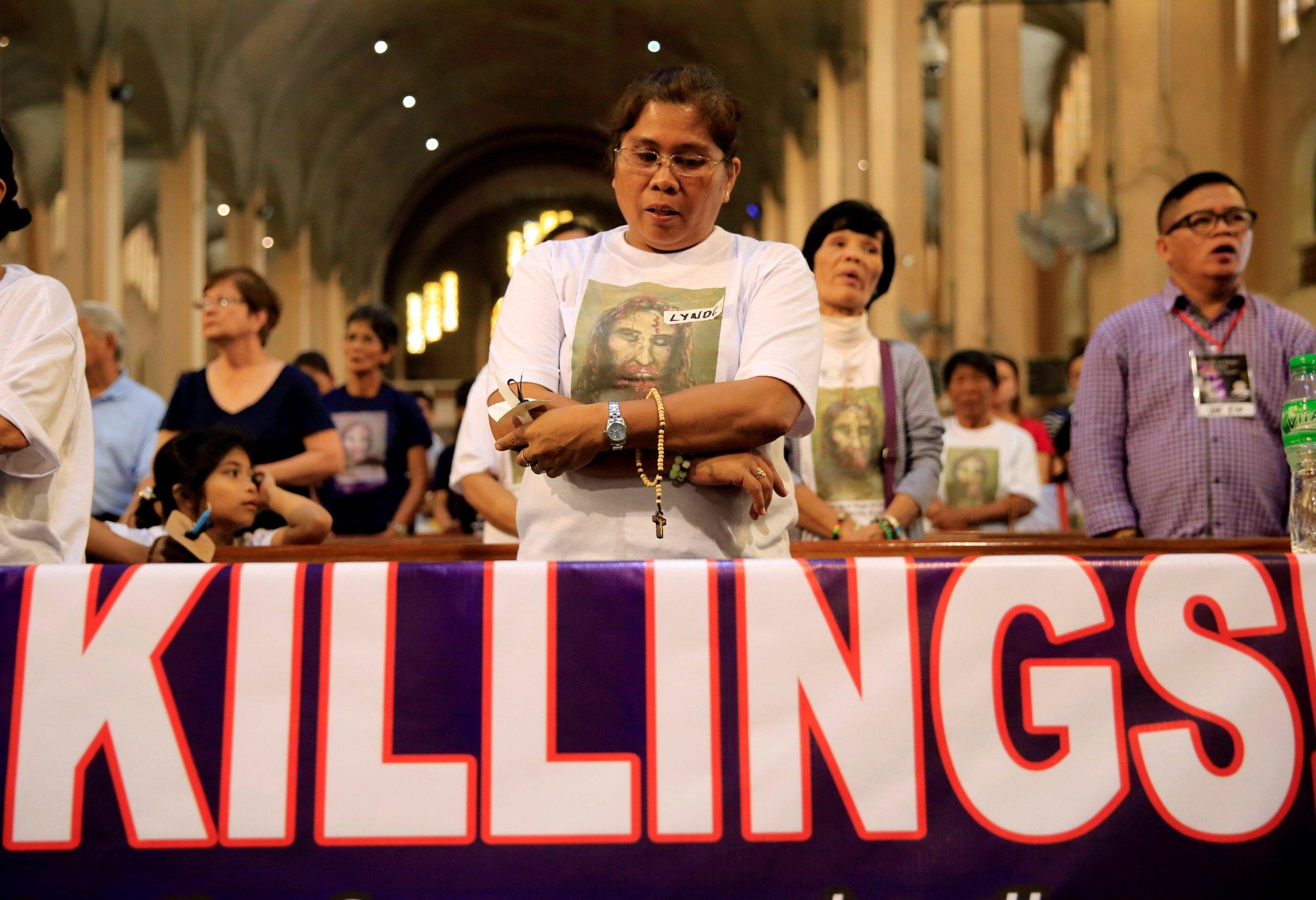 Woman protests killings