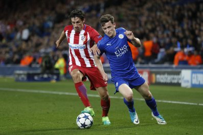 Atletico Madrid's Stefan Savic, left, with Leicester City's Ben Chilwell at King Power Stadium, Leicester, April 18.