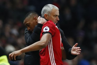 Manchester United striker Anthony Martial is congratulated by Jose Mourinho at Old Trafford, Manchester, February 11.