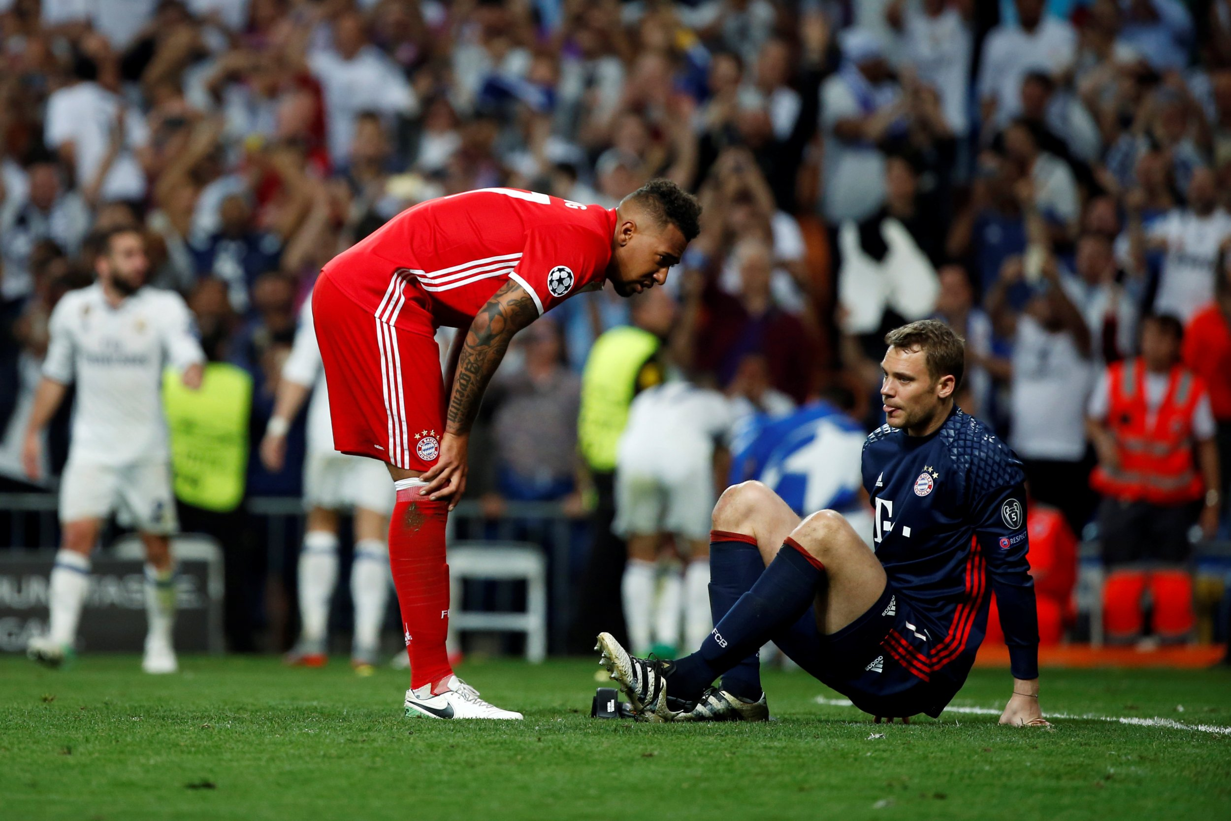 Bayern Munich's Jerome Boateng with goalkeeper Manuel Neuer at Santiago Bernabeu stadium, Madrid, April 18.