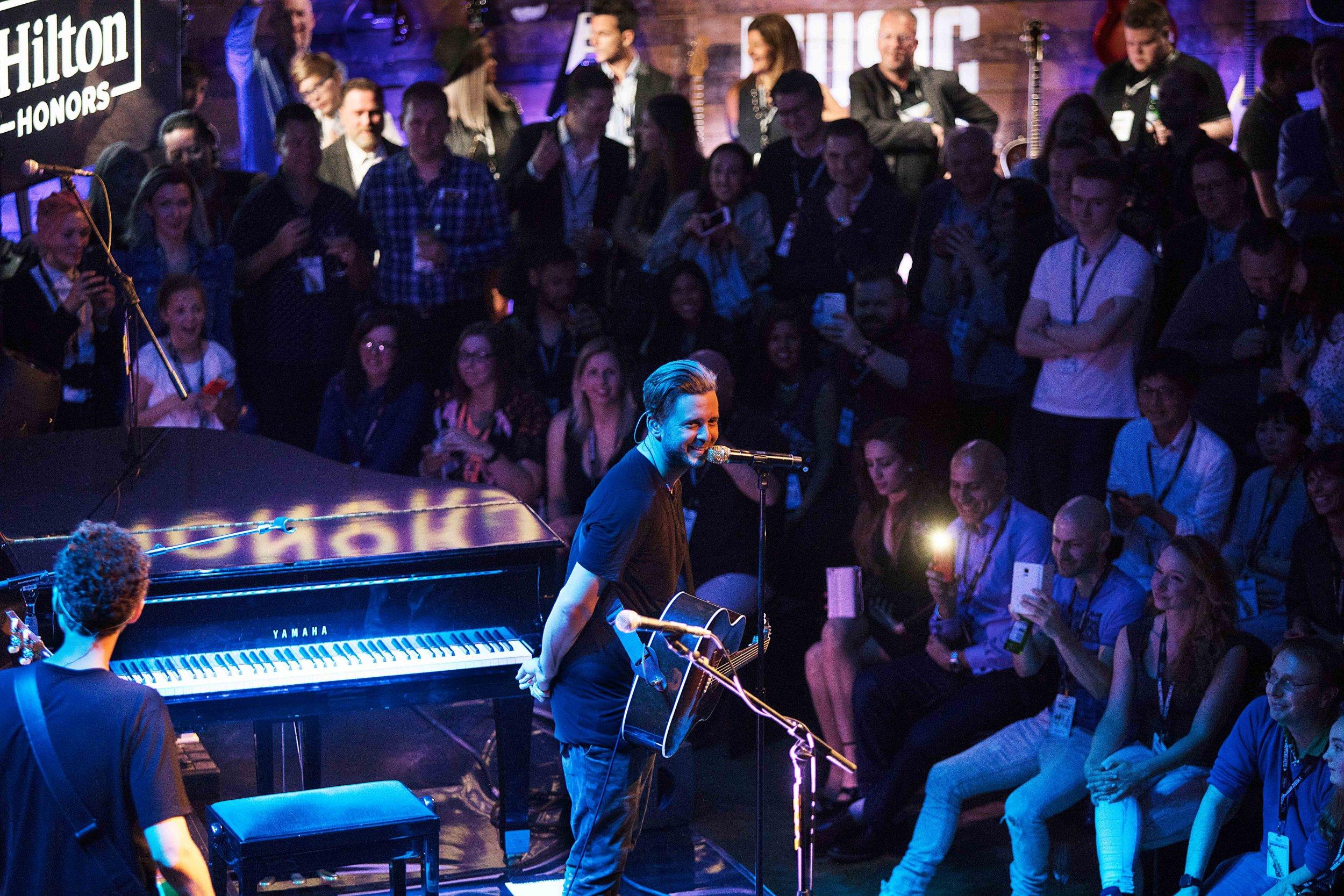 OneRepublic perform at Hilton Honors event