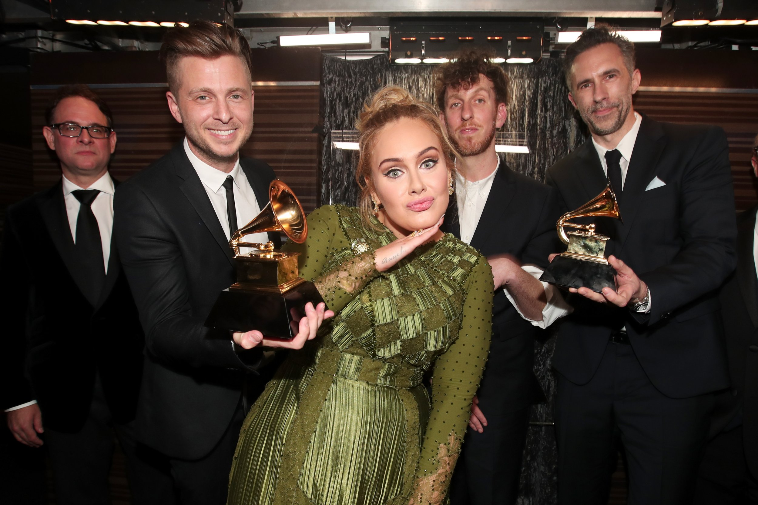 Adele and Ryan Tedder celebrate Grammy win