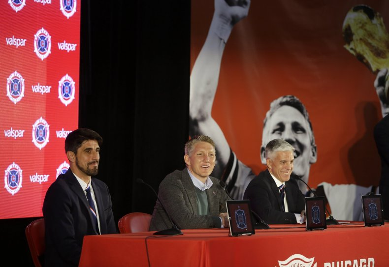 Chicago Fire general manager Nelson Rodriguez, far right, with Schweinsteiger and coach Veljko Paunovic in Chicago, Illinois, March 29.