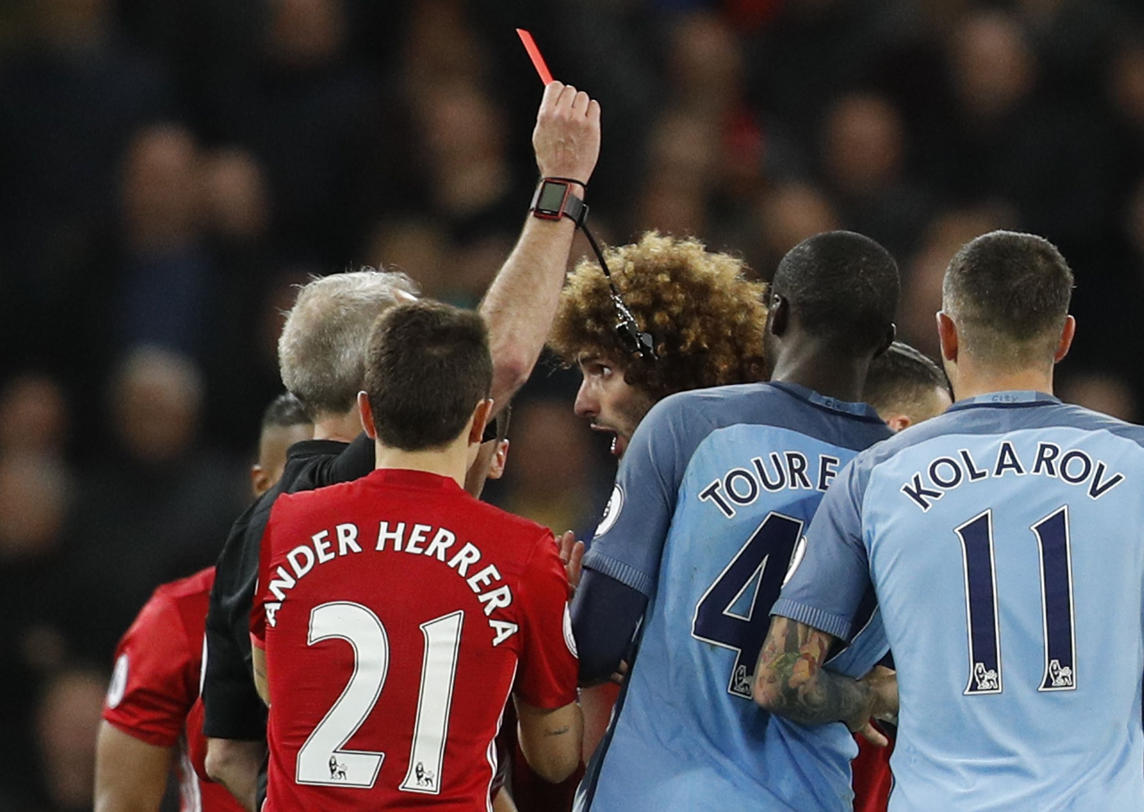Manchester United's Marouane Fellaini is shown a red card by referee Martin Atkinson at Etihad Stadium, Manchester, April 27.