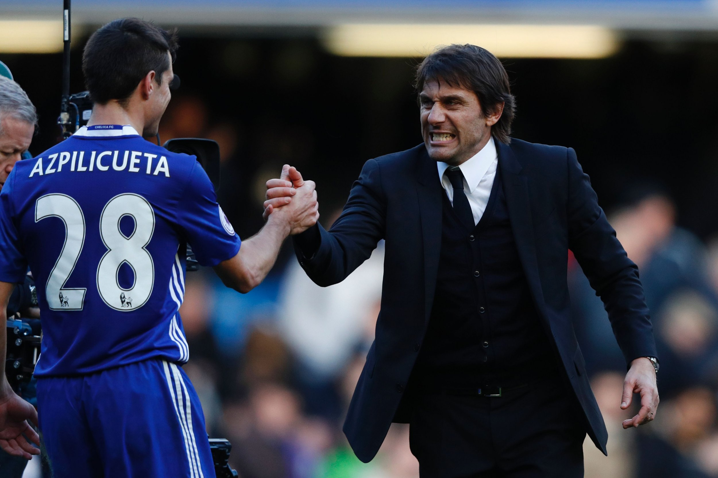 Chelsea manager Antonio Conte, right.